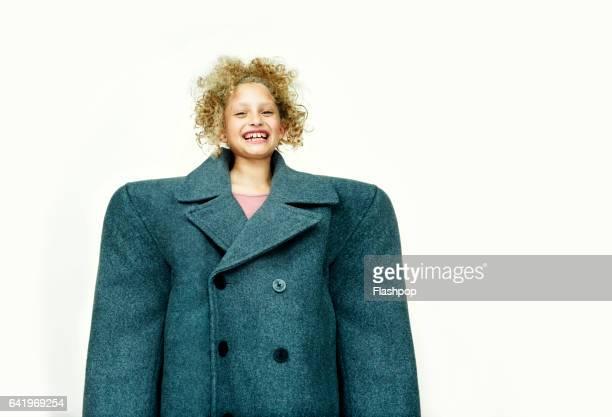 Portrait of girl waving huge coat