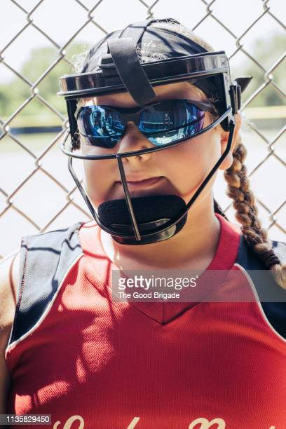 portrait of girl wearing catchers mask - baseball catcher stock pictures, royalty-free photos & images