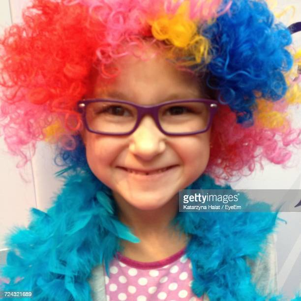 Portrait Of Girl Wearing Colorful Wig