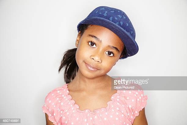 Portrait of girl (10-12) wearing denim baseball cap