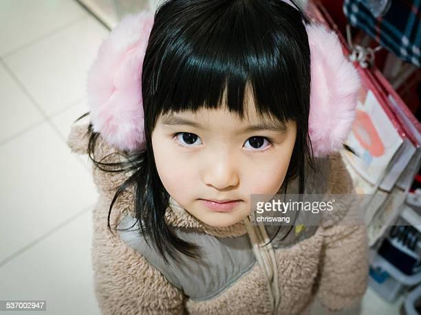 Portrait of girl wearing ear muff