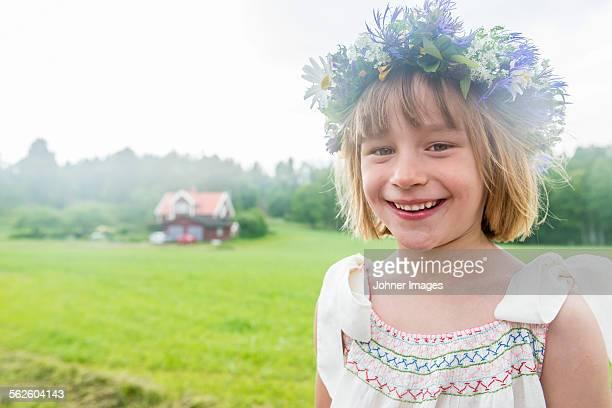 Portrait of girl wearing flower wreath