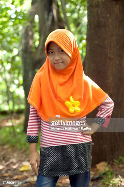 Portrait Of Girl Wearing Hijab Standing At Forest