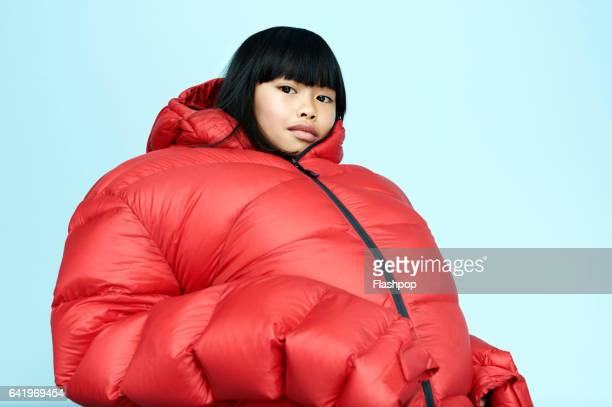 portrait of girl wearing huge coat - children only stock pictures, royalty-free photos & images