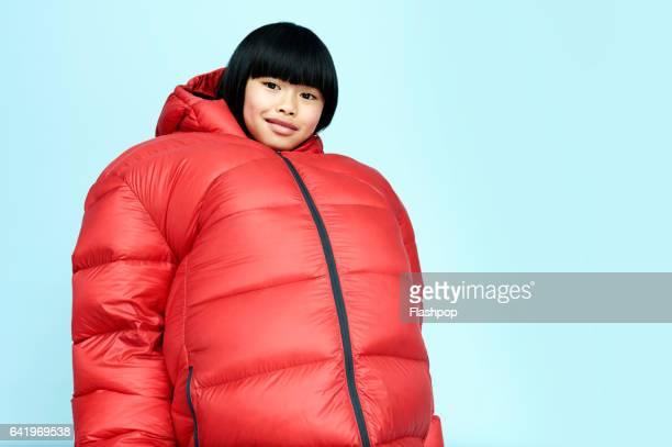 Portrait of girl wearing huge coat