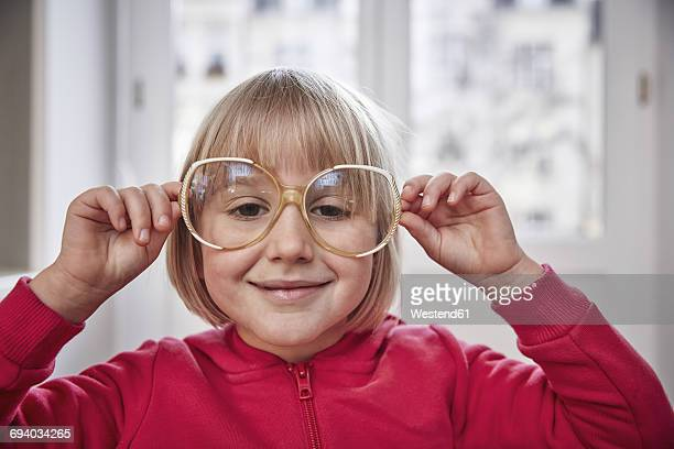 Portrait of girl wearing oversized glasses