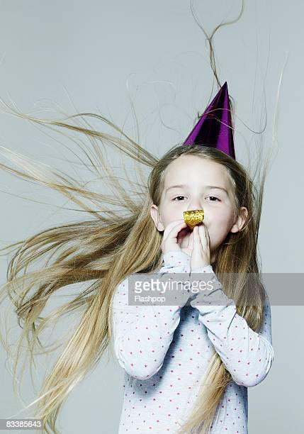 Portrait of girl wearing party hat