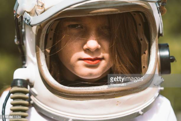 portrait of girl wearing space helmet - space helmet stock pictures, royalty-free photos & images