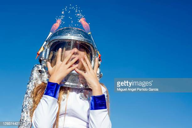 portrait of girl wearing space helmet - kids makeup stock pictures, royalty-free photos & images