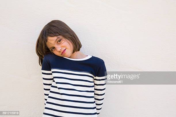 Portrait of girl wearing striped sweatshirt