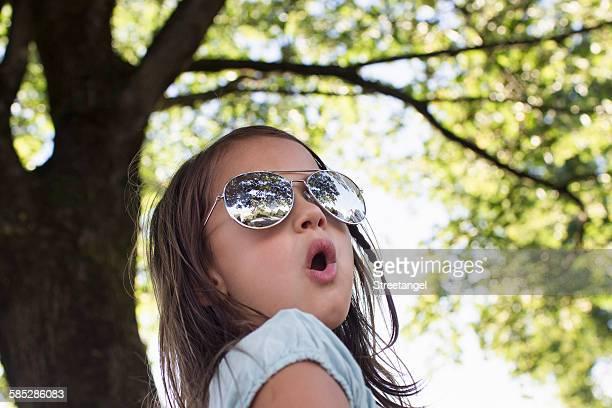 Portrait of girl wearing sunglasses in park