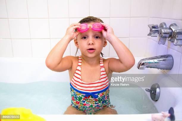 portrait of girl wearing swimming goggles in bath - swimming goggles stock pictures, royalty-free photos & images