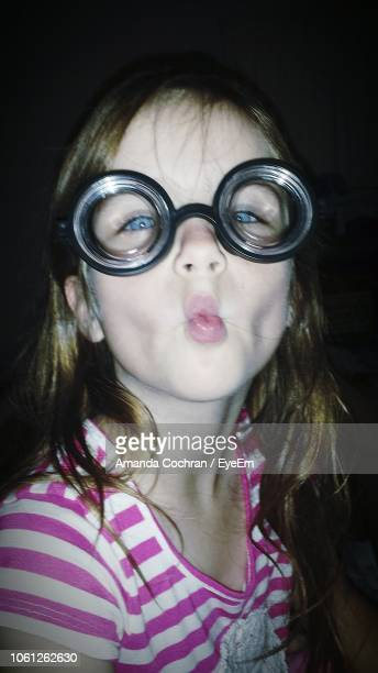 Portrait Of Girl Wearing Swimming Goggles