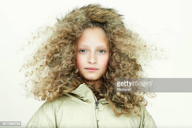 Portrait of girl wearing winter coat