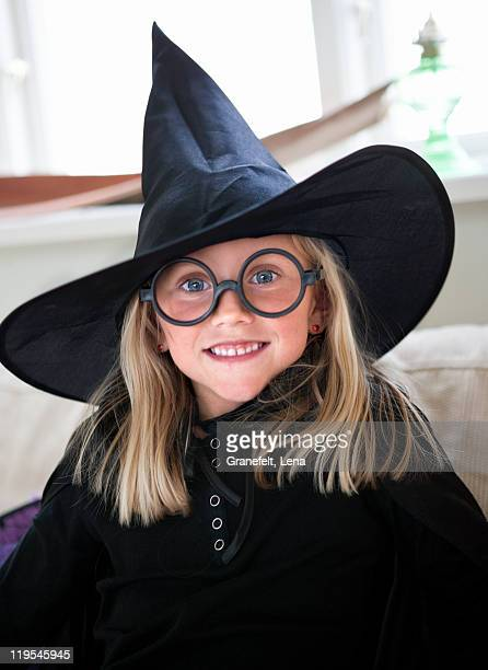 Portrait of girl wearing witchs hat