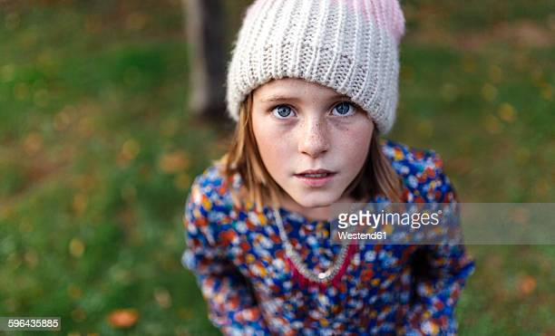 Portrait of girl wearing woollen cap looking up