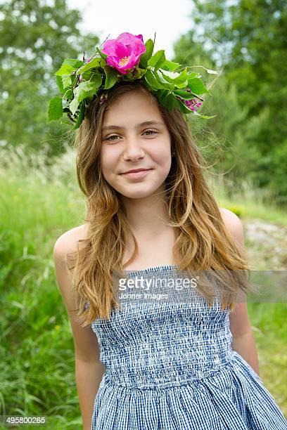 Portrait of girl wearing wreath of flowers, Nykoping, Sodermanland, Sweden