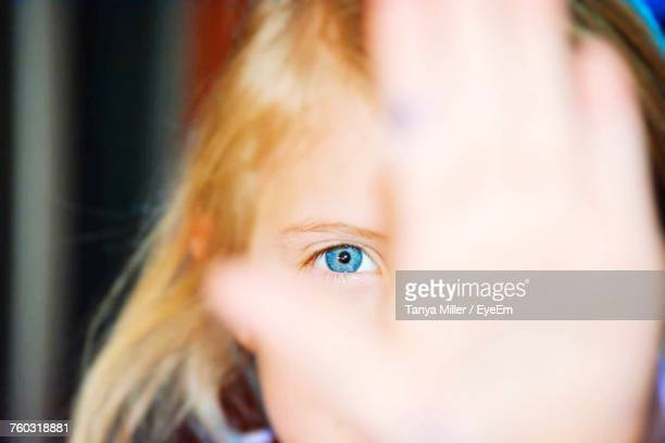 Portrait Of Girl With Blue Eyes Showing Palm