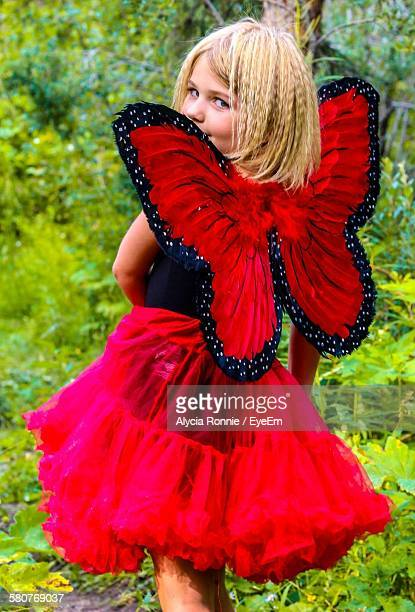 Portrait Of Girl With Butterfly Wing At Park