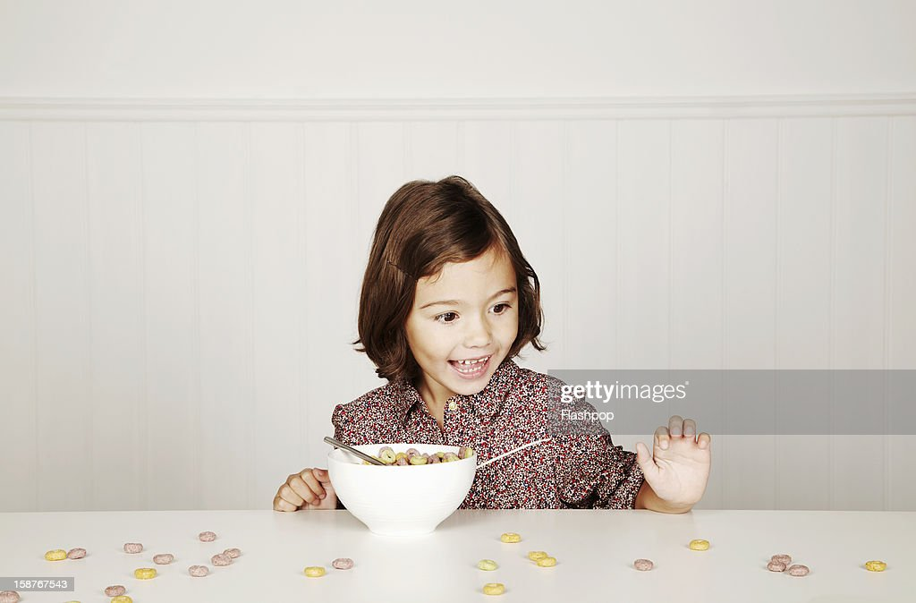 Portrait of girl with cereal : Stock Photo