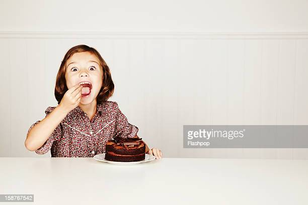 portrait of girl with chocolate cake - erotique photos et images de collection