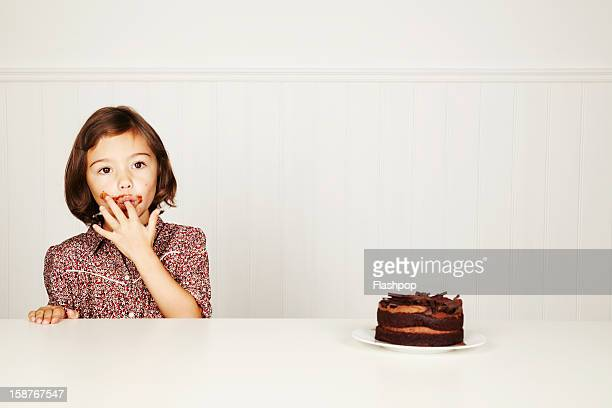 Portrait of girl with chocolate cake