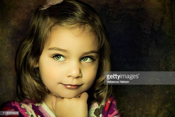 portrait of girl with cute thoughtful expression - rebecca nelson stock pictures, royalty-free photos & images