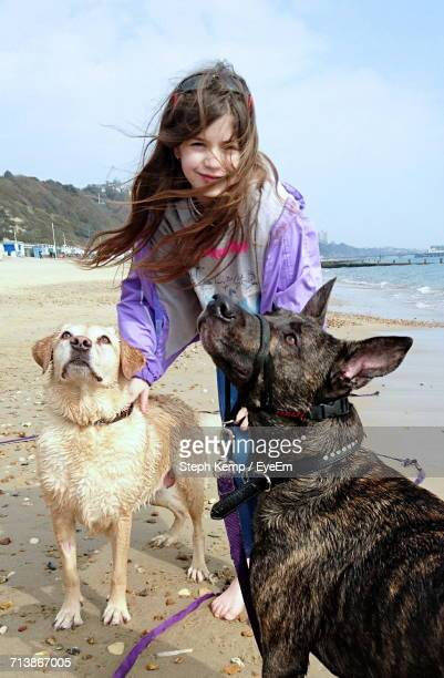 Portrait Of Girl With Dogs On Beach
