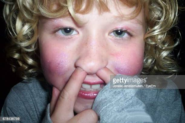 Portrait Of Girl With Fingers In Nose