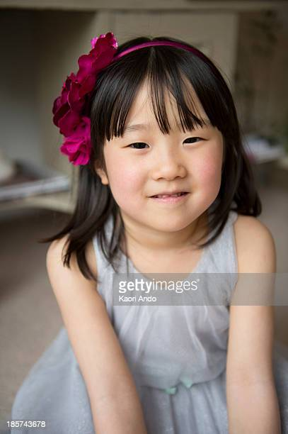 portrait of girl with flower in hair,  smiling - cobham surrey stock pictures, royalty-free photos & images