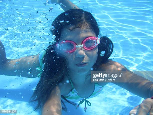 Portrait Of Girl With Goggles Swimming In Pool