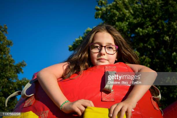 portrait of girl with inflatable toy - lévis quebec stock pictures, royalty-free photos & images