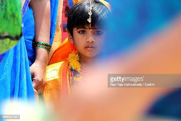 Portrait Of Girl With Mother In Traditional Clothing During Festival