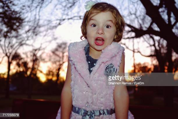 portrait of girl with mouth open during sunset - girls open mouth stock-fotos und bilder