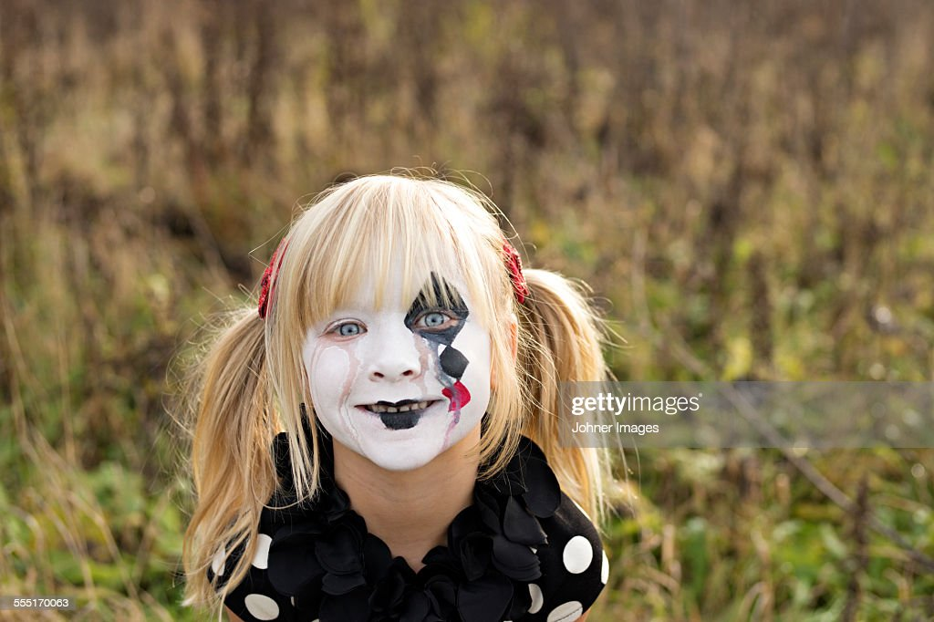 Portrait of girl with painted face : Stock Photo
