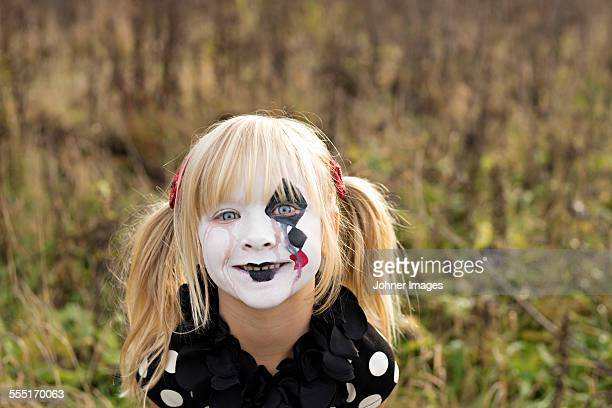 portrait of girl with painted face - happy clown faces stock photos and pictures