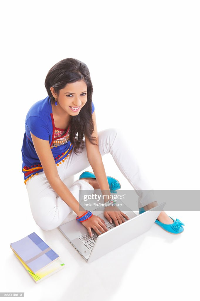 Portrait of girl working on laptop : Stock Photo