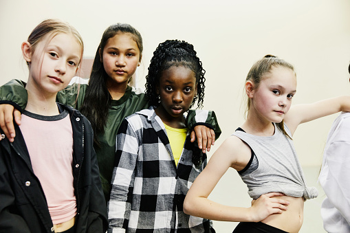Portrait of girls in hip hop dance group standing in studio after practice - gettyimageskorea