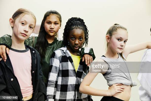 portrait of girls in hip hop dance group standing in studio after practice - pre adolescent child stock pictures, royalty-free photos & images