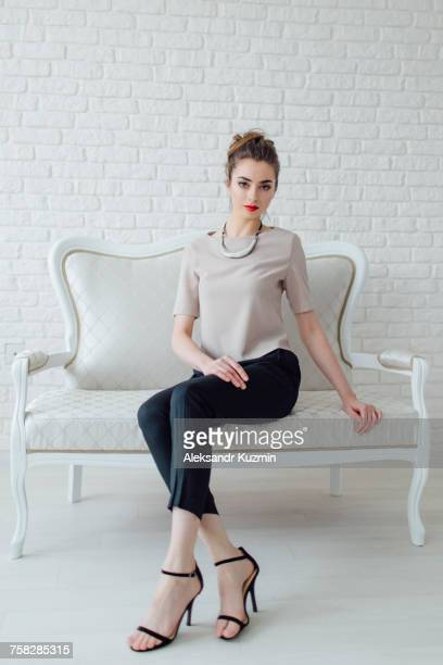portrait of glamorous middle eastern woman sitting on bench - 椅子 ストックフォトと画像