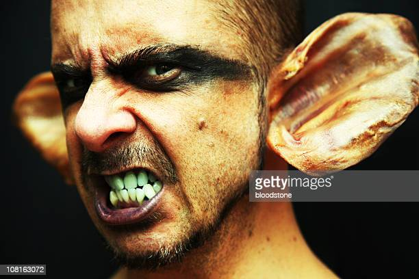 portrait of goblin man with pigs ears - goblin stock photos and pictures