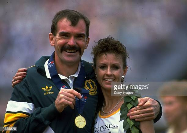 Portrait of gold medal winners Rob de Castella and Lisa Martin of Australia after the Marathon event during the Commonwealth Games in Edinburgh,...