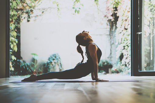 Portrait of gorgeous young woman practicing yoga indoor. Beautiful girl 623774908