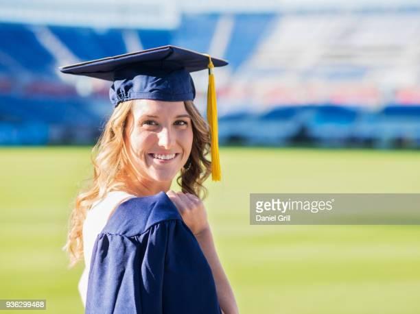 Portrait of graduate student in stadium