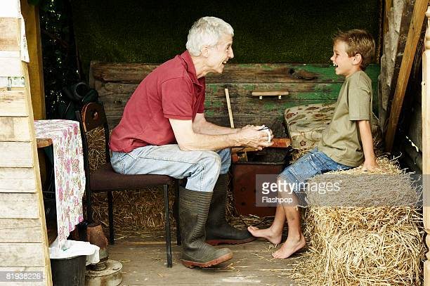 portrait of grandfather and grandson  - generation gap stock pictures, royalty-free photos & images
