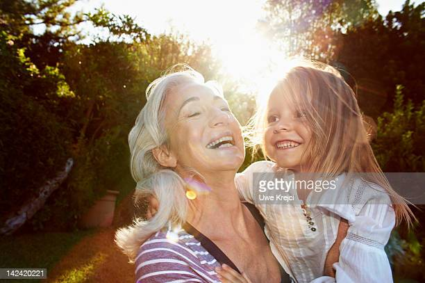 portrait of grandmother and girl (4 - 5 y) - grandmother stock pictures, royalty-free photos & images