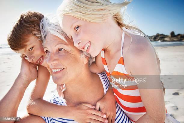 Portrait of Grandmother and grandchildren on beach