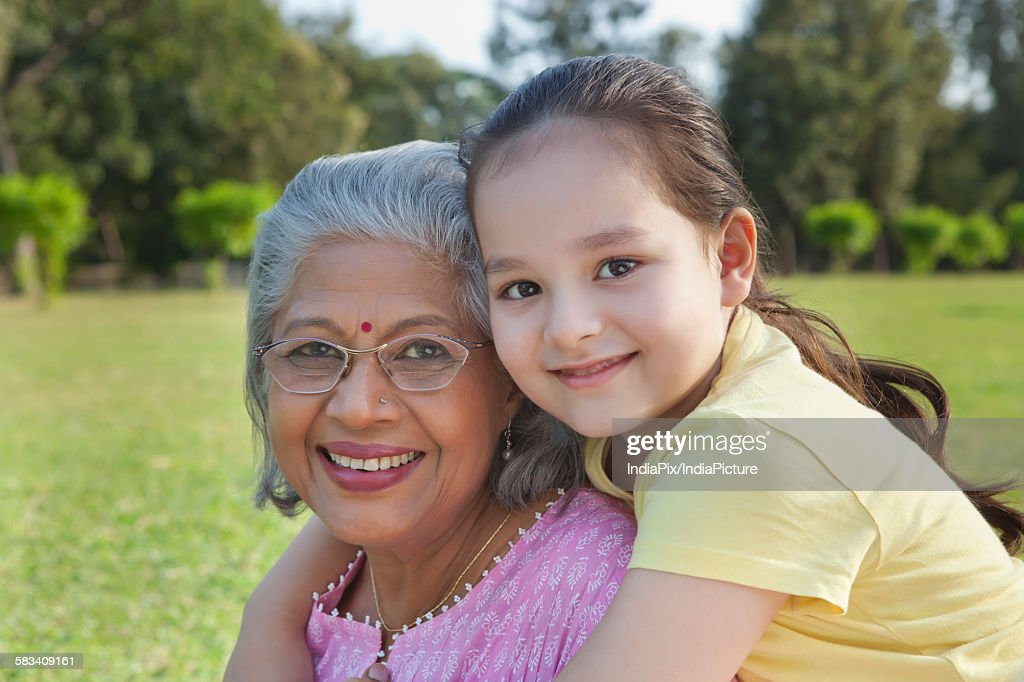 Portrait of grandmother and granddaughter smiling : Stock Photo