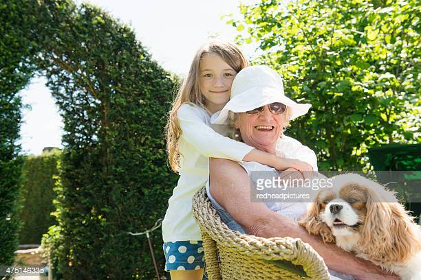 Portrait of grandmother and granddaughter with dog