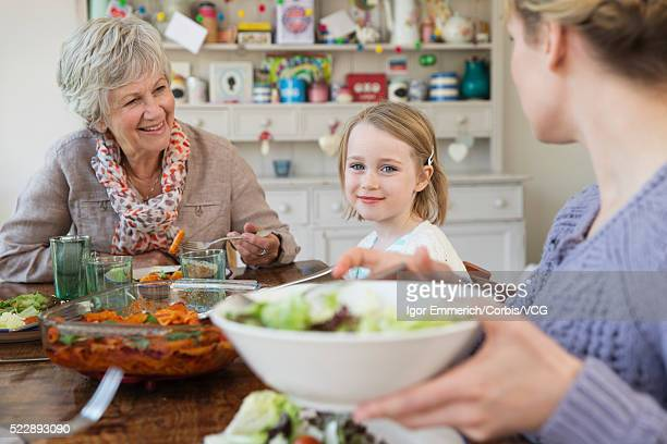 Portrait of grandmother, mother and daughter (4-5) at table
